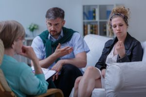 Father and teen in family therapy
