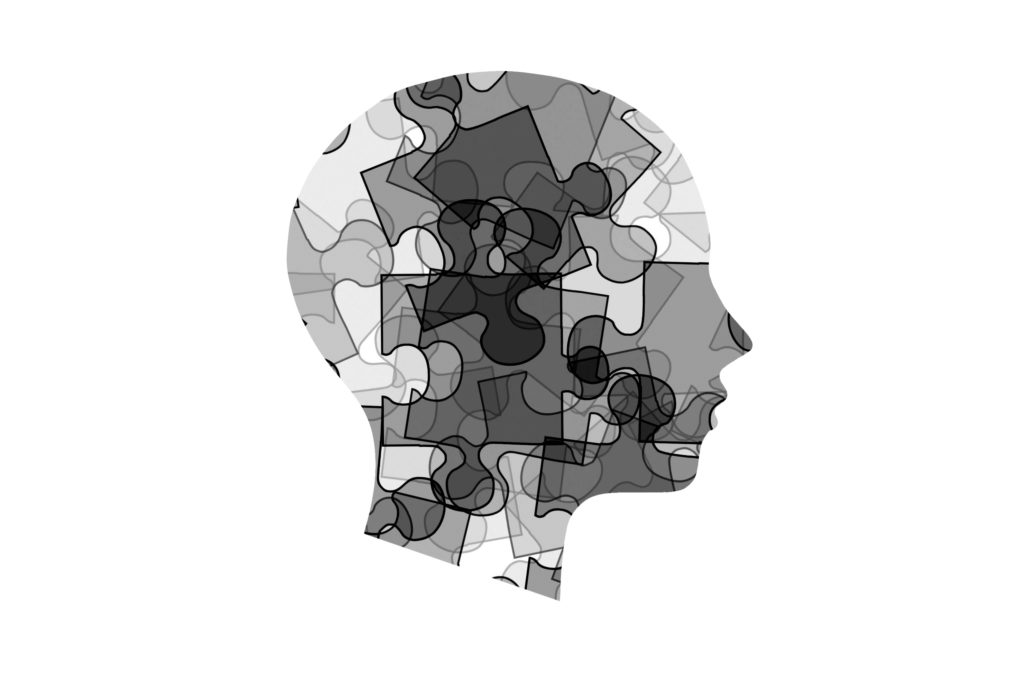 illustration of man's head with puzzle pieces