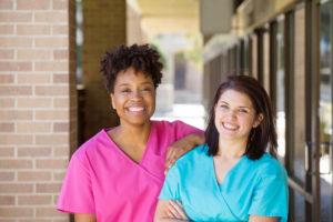 Two smiling nurses
